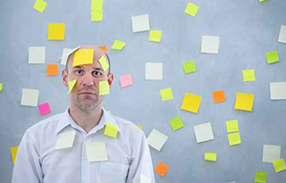 Man-Standing-in-Post-its